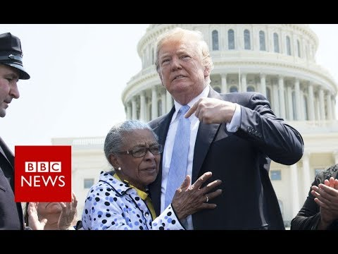 Trump shares warm moment with slain police officer\'s family - BBC News
