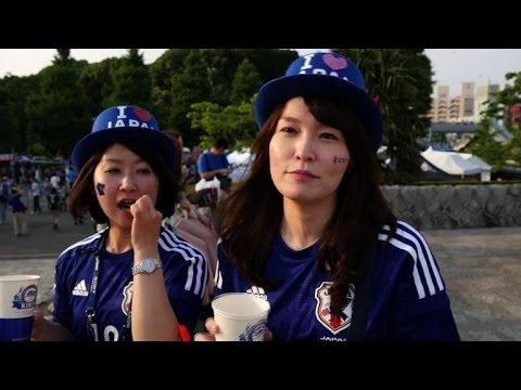 Japanese football squad get rock star send-off for World Cup
