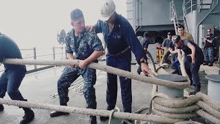 Sailors Pull Mooring Lines Aboard Aircraft Carrier USS George H.W. Bush