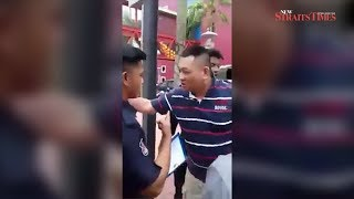 Viral video: Man challenges council officers in Cheras to fight after finding car clamped