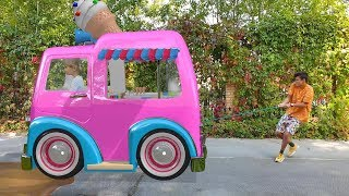 Alena and Pasha play with Ice cream minibus