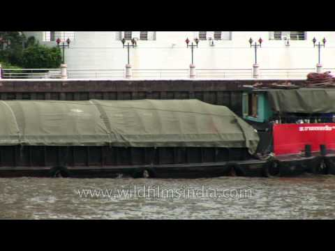 A cargo barge moving along main river in Bangkok