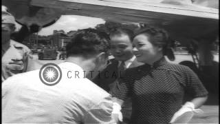 Madame Chiang Kai-shek with American Red Cross girls, boards C-54 Skymaster and l...HD Stock Footage