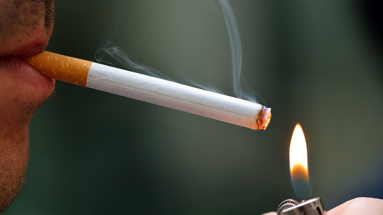 Cigarettes sold in plain green packs under new rules