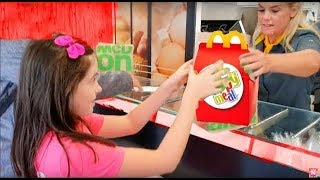 Kids Ordering Food from the Shop