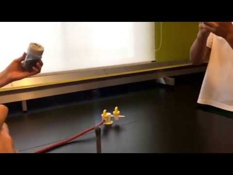 Magnesium Powder Poured Into Bunsen Burner - Slow-Mo