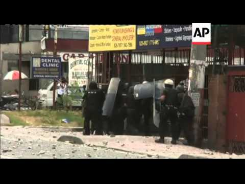 Riot police clash with squatters resisting demolition along major road in Manila
