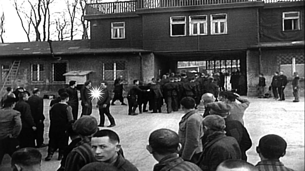 Funeral procession and view of entrance gate at Buchenwald ...