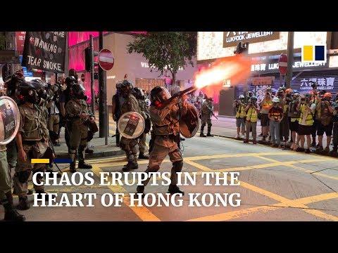Sunday protests spiral into chaos as Hong Kong police and demonstrators clash
