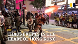 Sunday protests spiral into chaos as Hong Kong police and demonstrators clash