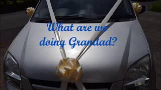 Decorating wedding car with ribbon bows
