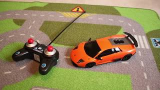 Kids playing with two RC Revell Lamborghinis! Aventador, Murcielago. Unboxing and driving