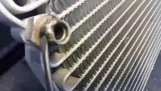 Ремонт радиатора  кондиционера John Deere
