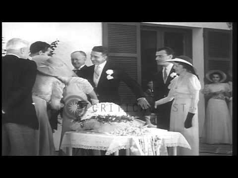 Mary Pickford and Buddy Rogers being greeted by guests after their wedding in Bel...HD Stock Footage