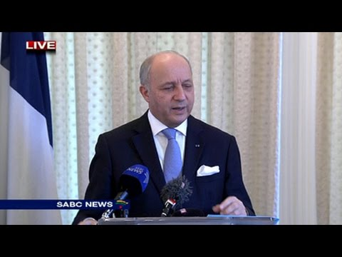 French Foreign Minister Laurent Fabius addressing the media