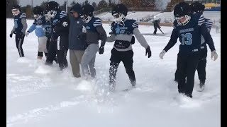 Mona Shores football team prepares for Portage Northern in snow and cold