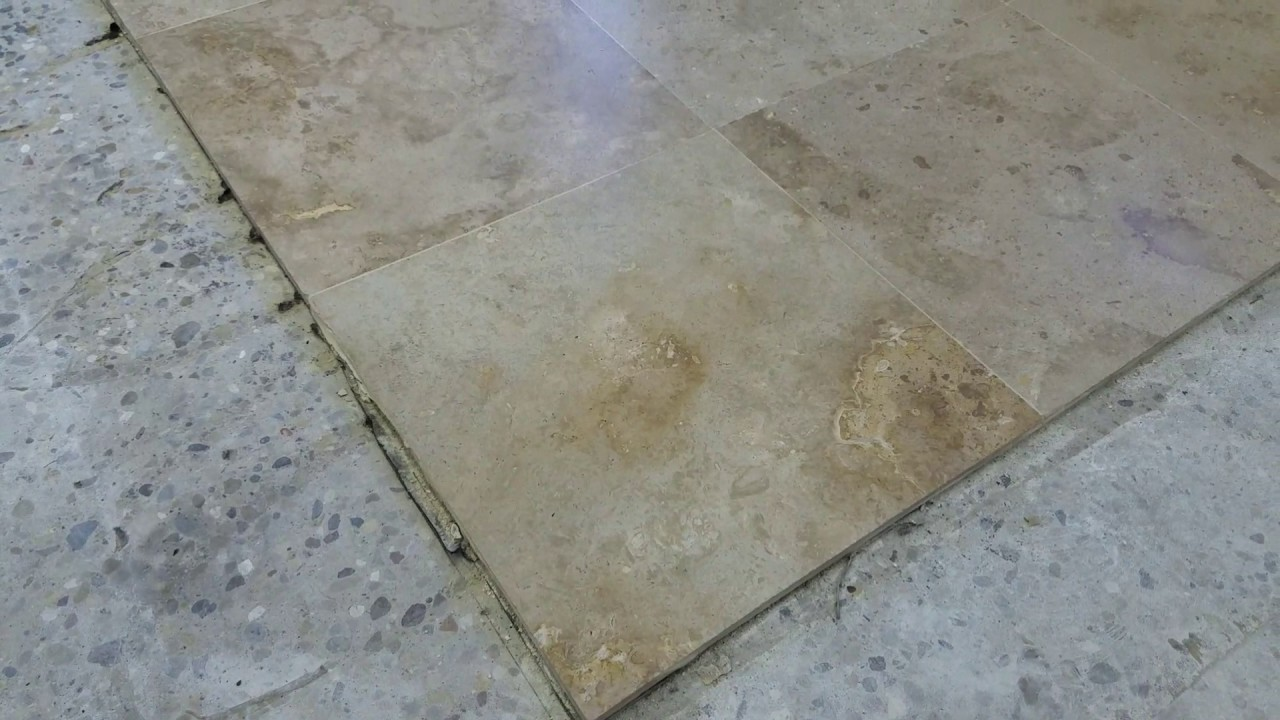 travertine tile floor restoration with lippage free and epoxy grout system