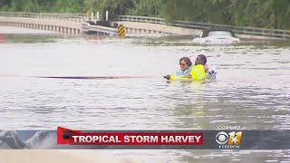 People Get Stuck Trying To Drive Through Houston Flood Waters