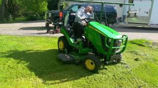 Dads mowing grass with my 1025R john deere