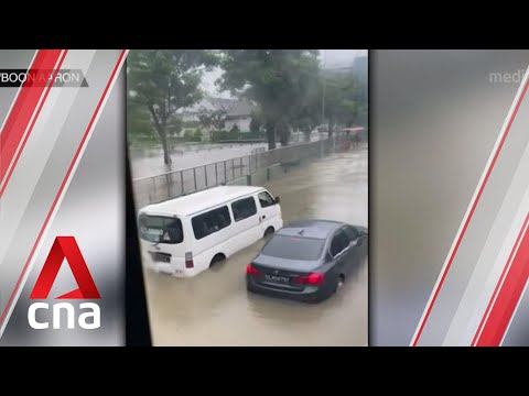 Flash floods reported in parts of Singapore after heavy downpour