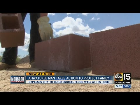 Ahwatukee man building his own flood wall