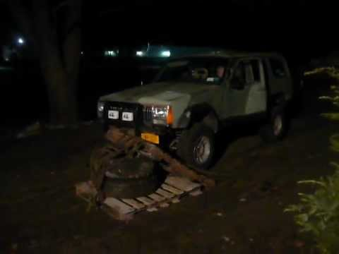 flexing a 90 jeep cherokee xj lifted with super swamper tsl camo