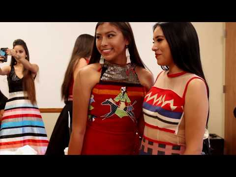 A RED BERRY WOMAN NATIVE FASHION SHOW