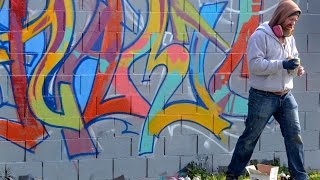 Graffiti artists paint massive wall at the Bizarre Art Festival