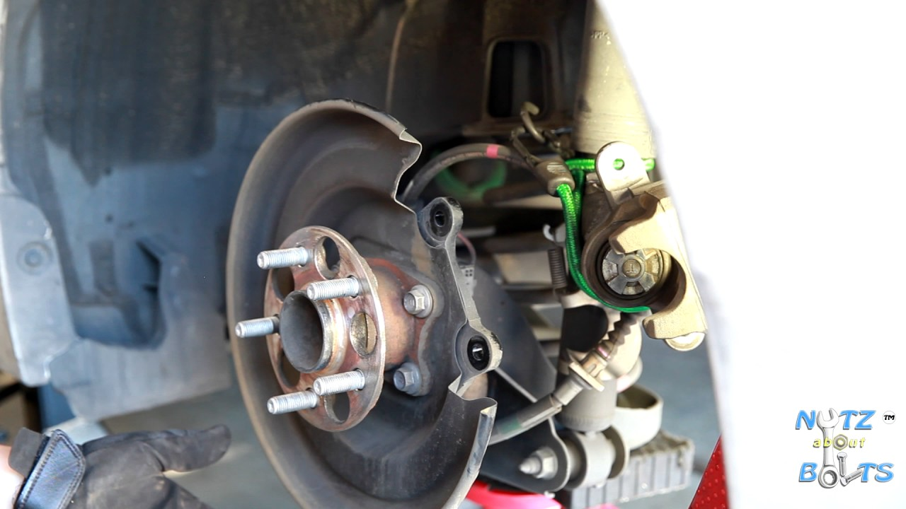 2010 2015 toyota prius rear brake pads and rotors remove and install [ 1280 x 720 Pixel ]