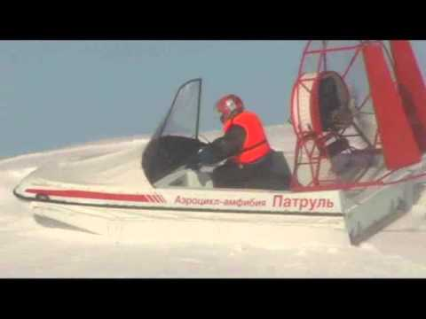 Вид сбоку на аэросани-амфибия Патруль в движении фото