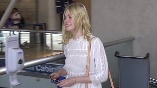 Elle Fanning Goes Braless Through LAX