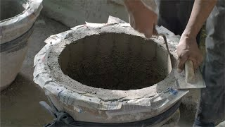 Shot of an Indian potter making cement planter (Gamla)
