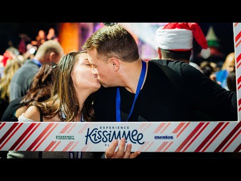 Download Youtube: Gaylord Palms Resort breaks Guinness World Record for most couples kissing under mistletoe