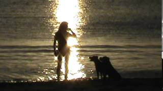 Sunset beach scene with dogs.  Playa Potrero, Costa Rica by ARS Video, Inc