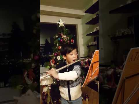 Lester playing flute @ silent night (5.5 yo)