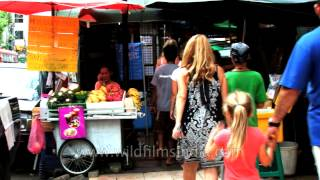 Thai and expat women visit market in Thailand