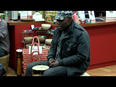 Sam Manzanza drumming at Trade Aid Wgtn