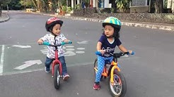 balance bike / push bike - toddler children playing together with their bike - belajar sepeda