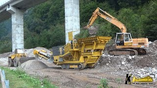Liebherr R932 Loading Hartl Crusher and Hanomag 66C Cleaning Material