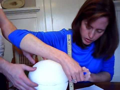 Ben Holt - Mrs. Kepner cutting ball for Model of Interior of Earth Project Part 1