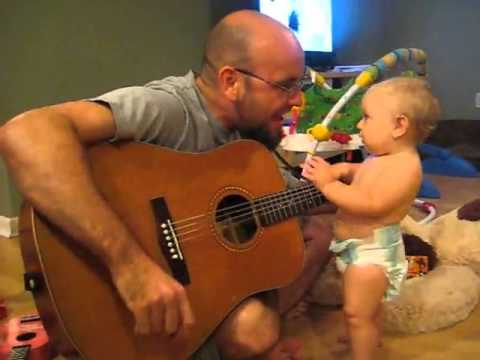 Baby rocks out with dad playing Bon Jovi