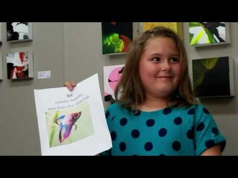 reagan williams reading her fish poem at children's poetry day.
