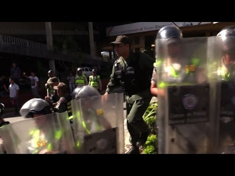 Venezuelan opposition MPs clash with police