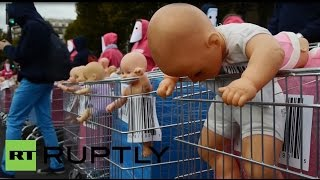 France: Anonymous mothers sell their 'babies' at Paris demo