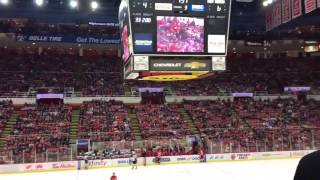 Fans at a hockey game go crazy for a little kid; boo everyone else