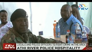 Locals and police officers mingle during open day in Athi River