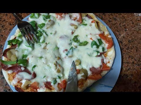 صورة  طريقة عمل البيتزا طريقة عمل البيتزا بفكرة مختلفة ومختصرة للوقت طريقة عمل البيتزا من يوتيوب
