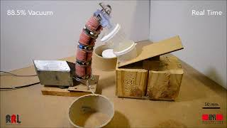 Vacuum-powered suction manipulation with a continuum robot
