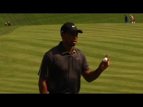 Tiger Woods sticks approach from rough to 2 feet at Bridgestone