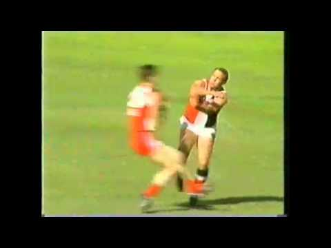 Tony Lockett caves in Peter Caven's lid